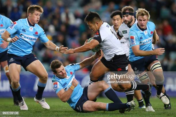 Yusuke Niwai of the Sunwolves makes a break during the round 18 Super Rugby match between the Waratahs and the Sunwolves at Allianz Stadium on July 7...