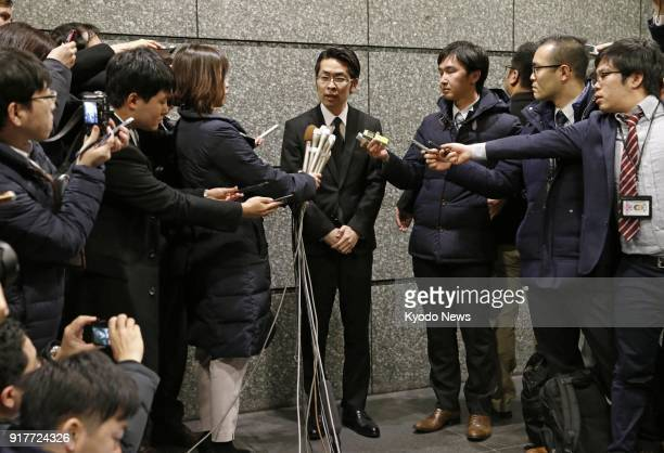 Yusuke Otsuka a board director of Coincheck Inc speaks to reporters in Tokyo on Feb 13 after submitting a business improvement package to the...