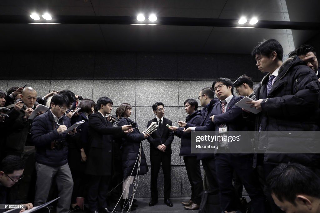 Yusuke Otsuka, chief operating officer and co-founder of Coincheck Inc., center, speaks to members of the media at an entrance lobby of the building housing the company's headquarters in Tokyo, Japan, on Tuesday, Feb. 13, 2018. Cryptocurrency exchange Coincheckusers withdrew 40.1 billion yen ($373 million) from the cryptocurrency exchange on Tuesday, the first day customers were allowed to pull out in the wake of the cyber-theft of about$500 millionlast month. Photographer: Kiyoshi Ota/Bloomberg via Getty Images