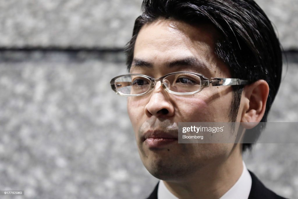 Yusuke Otsuka, chief operating officer and co-founder of cryptocurrency exchange Coincheck Inc., pauses as he speaks to members of the media at an entrance lobby of the building housing the company's headquarters in Tokyo, Japan, on Tuesday, Feb. 13, 2018. Coincheckusers withdrew 40.1 billion yen ($373 million) from the cryptocurrency exchange on Tuesday, the first day customers were allowed to pull out in the wake of the cyber-theft of about$500 millionlast month. Photographer: Kiyoshi Ota/Bloomberg via Getty Images
