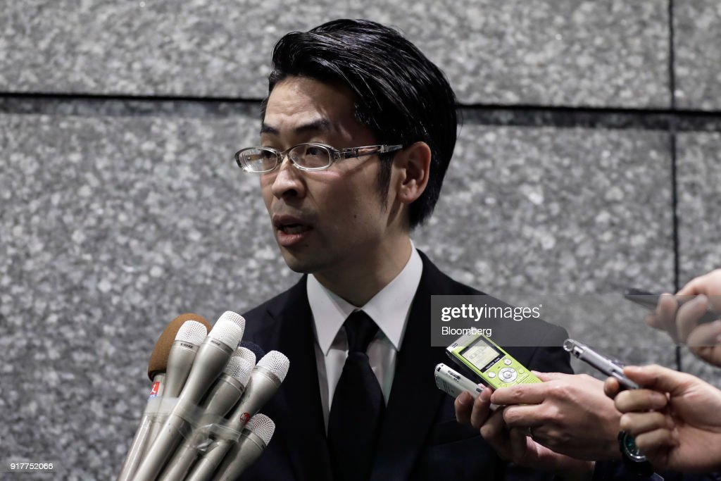 Yusuke Otsuka, chief operating officer and co-founder of cryptocurrency exchange Coincheck Inc., speaks to members of the media at an entrance lobby of the building housing the company's headquarters in Tokyo, Japan, on Tuesday, Feb. 13, 2018. Coincheckusers withdrew 40.1 billion yen ($373 million) from the cryptocurrency exchange on Tuesday, the first day customers were allowed to pull out in the wake of the cyber-theft of about$500 millionlast month. Photographer: Kiyoshi Ota/Bloomberg via Getty Images