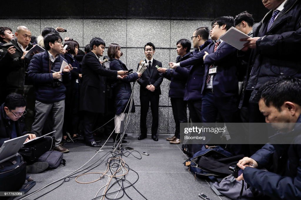 Yusuke Otsuka, chief operating officer and co-founder of cryptocurrency exchange Coincheck Inc., center, speaks to members of the media at an entrance lobby of the building housing the company's headquarters in Tokyo, Japan, on Tuesday, Feb. 13, 2018. Coincheckusers withdrew 40.1 billion yen ($373 million) from the cryptocurrency exchange on Tuesday, the first day customers were allowed to pull out in the wake of the cyber-theft of about$500 millionlast month. Photographer: Kiyoshi Ota/Bloomberg via Getty Images