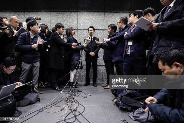 Yusuke Otsuka chief operating officer and cofounder of cryptocurrency exchange Coincheck Inc center speaks to members of the media at an entrance...