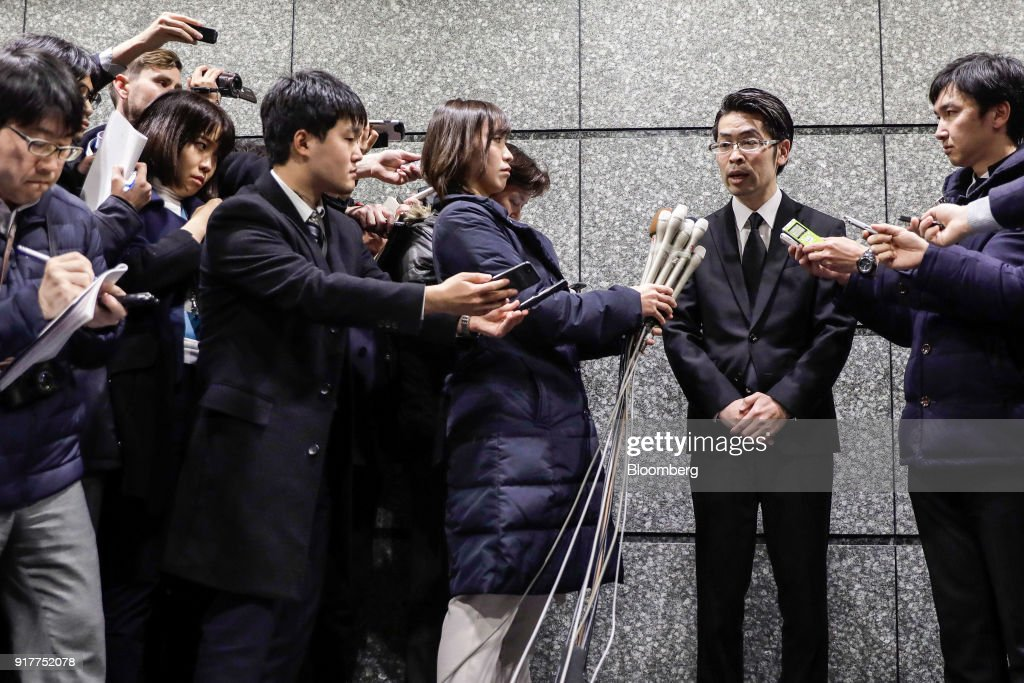 Yusuke Otsuka, chief operating officer and co-founder of cryptocurrency exchange Coincheck Inc., second from right, speaks to members of the media at an entrance lobby of the building housing the company's headquarters in Tokyo, Japan, on Tuesday, Feb. 13, 2018. Coincheckusers withdrew 40.1 billion yen ($373 million) from the cryptocurrency exchange on Tuesday, the first day customers were allowed to pull out in the wake of the cyber-theft of about$500 millionlast month. Photographer: Kiyoshi Ota/Bloomberg via Getty Images