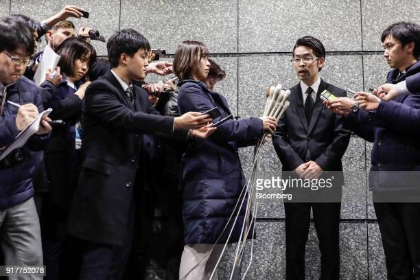 Yusuke Otsuka chief operating officer and cofounder of cryptocurrency exchange Coincheck Inc second from right speaks to members of the media at an...
