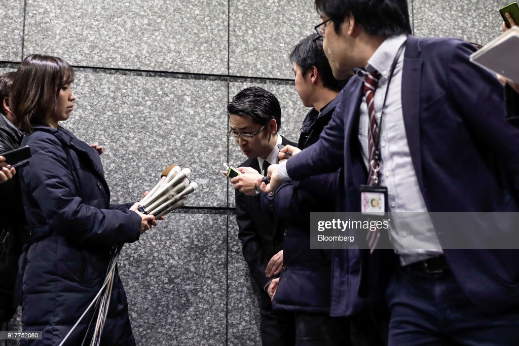 Yusuke Otsuka, chief operating officer and co-founder of cryptocurrency exchange Coincheck Inc., center, bows as he leaves after speaking in front of the media at an entrance lobby of the building housing the company's headquarters in Tokyo, Japan, on Tuesday, Feb. 13, 2018. Coincheckusers withdrew 40.1 billion yen ($373 million) from the cryptocurrency exchange on Tuesday, the first day customers were allowed to pull out in the wake of the cyber-theft of about$500 millionlast month. Photographer: Kiyoshi Ota/Bloomberg via Getty Images