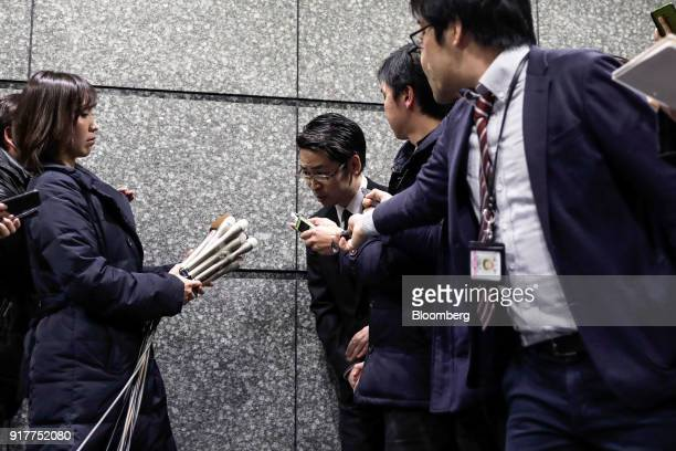 Yusuke Otsuka chief operating officer and cofounder of cryptocurrency exchange Coincheck Inc center bows as he leaves after speaking in front of the...