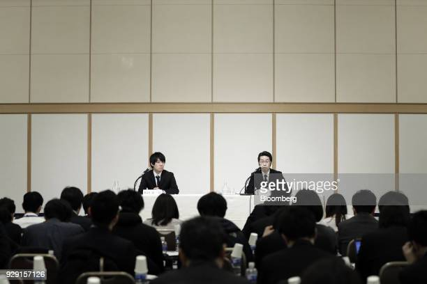 Yusuke Otsuka chief operating officer of Coincheck Inc right speaks as Koichiro Wada president of Coincheck Inc looks on during a news conference in...