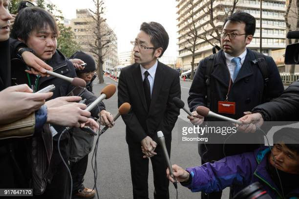 Yusuke Otsuka chief operating officer of Coincheck Inc speaks to members of the media outside of the Financial Services Agency headquarters in Tokyo...