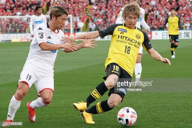Yusuke Segawa of Kashiwa Reysol and Kosuke Shirai of Consadole Sapporo compete for the ball during the JLeague MEIJI YASUDA J1 match between Kashiwa...