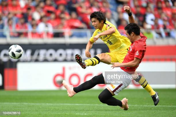 Yusuke Segawa of Kashiwa Reysol and Takuya Iwanami of Urawa Red Diamonds compete for the ball during the JLeague J1 match between Urawa Red Diamonds...