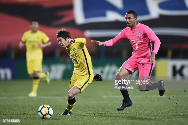 Yusuke Segawa of Kashiwa Reysol competes for the ball against Azevedo Pedreira of Kitchee SC during the AFC Champions League Group E match between...