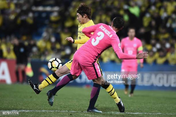 Yusuke Segawa of Kashiwa Reysol competes for the ball against Dani Cancela Rodriguez of Kitchee SC of Kitchee SC during the AFC Champions League...