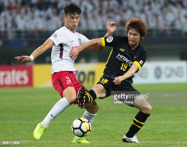 Yusuke Segawa of Kashiwa Reysol of Kashiwa Reysol competes the ball with Wang Jie of Tianjin Quanjian during the AFC Champions League Group E match...