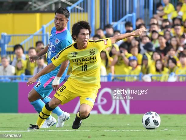 Yusuke Segawa of Kshiwa Reysol and Yuji Ono of Sagan Tosu compete for the ball during the JLeague J1 match between Kashiwa Reysol and Sagan Tosu at...