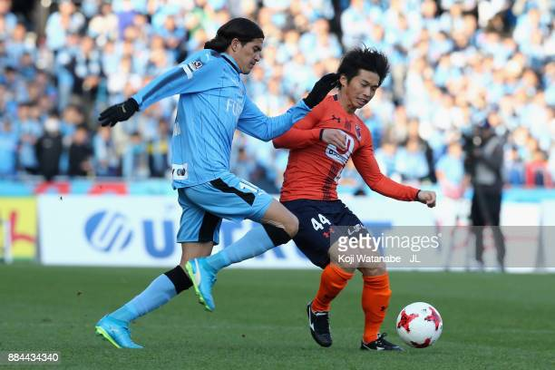 Yusuke Segawa of Omiya Ardija and Elsinho of Kawasaki Frontale compete for the ball during the JLeague J1 match between Kawasaki Frontale and Omiya...
