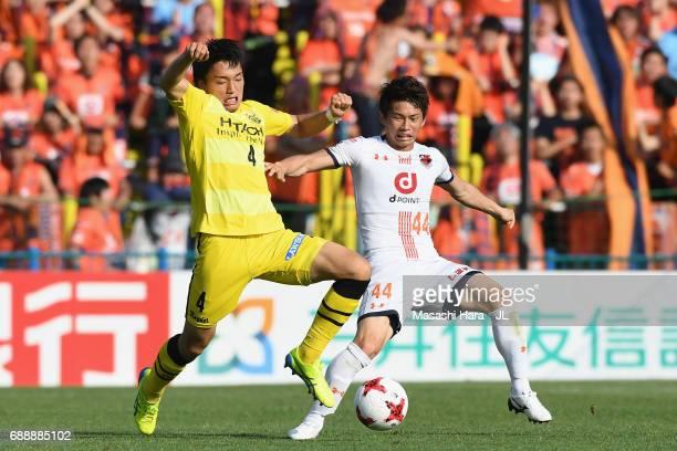 Yusuke Segawa of Omiya Ardija and Shinnosuke Nakatani of Kashiwa Reysol compete for the ball during the JLeague J1 match between Kashiwa Reysol and...