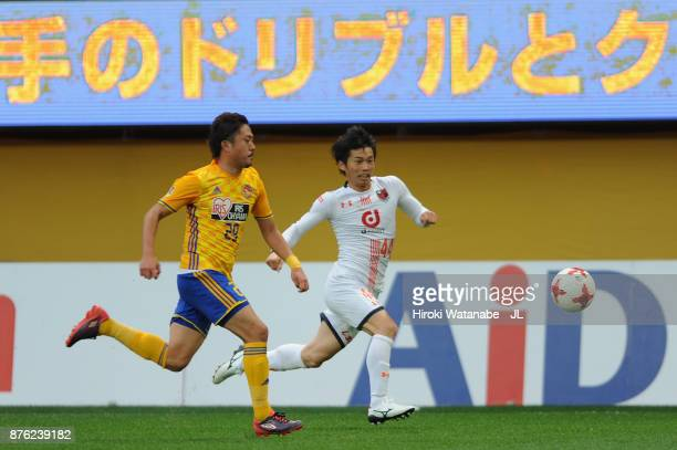 Yusuke Segawa of Omiya Ardija and Shota Kobayashi of Vegalta Sendai compete for the ball during the JLeague J1 match between Vegalta Sendai and Omiya...