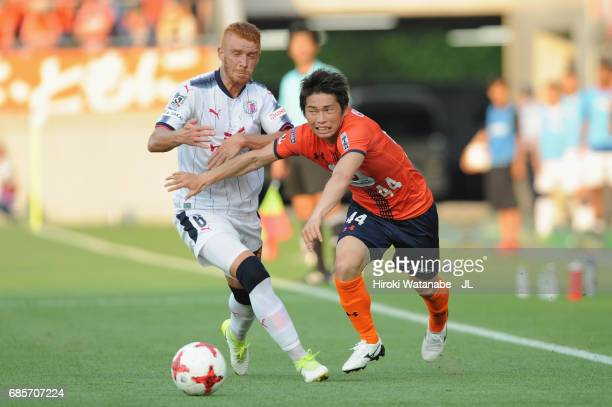 Yusuke Segawa of Omiya Ardija and Souza of Cerezo Osaka compete for the ball during the JLeague J1 match between Omiya Arija and Cerezo Osaka at NACK...