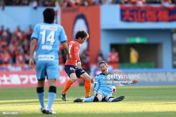 Yusuke Segawa of Omiya Ardija and Tatsuki Nara of Kawasaki Frontale compete for the ball during the JLeague J1 match between Kawasaki Frontale and...