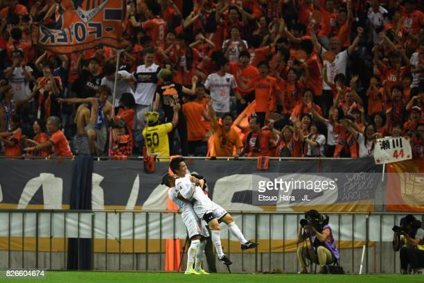Yusuke Segawa of Omiya Ardija celebrates scoring his side's second goal during the JLeague J1 match between Urawa Red Diamonds and Omiya Ardija at...