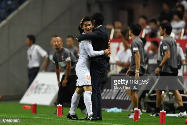 Yusuke Segawa of Omiya Ardija celebrates scoring his side's second goal with head coach Akira Ito during the JLeague J1 match between Urawa Red...