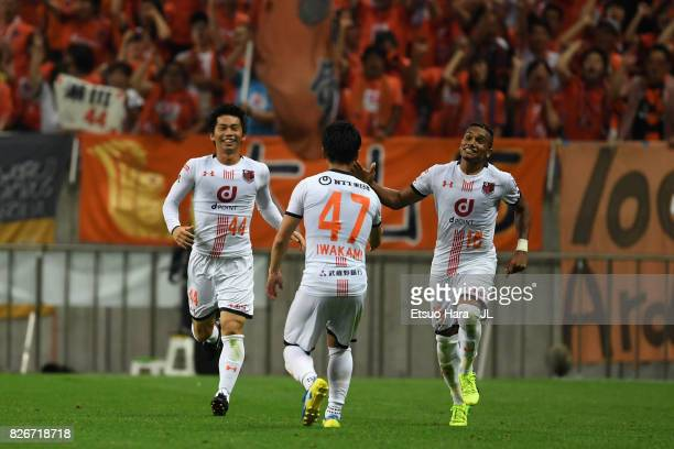 Yusuke Segawa of Omiya Ardija celebrates scoring his side's second goal with his team mates Yuzo Iwakami and Mateus during the JLeague J1 match...