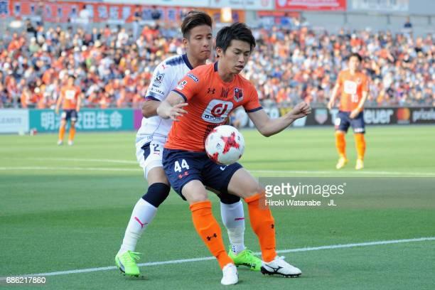 Yusuke Segawa of Omiya Ardija controls the ball under pressure of Riku Matsuda of Cerezo Osaka during the JLeague J1 match between Omiya Arija and...