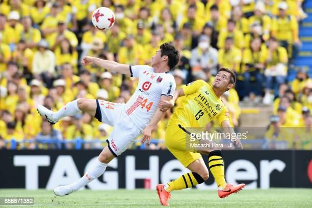 Yusuke Segawa of Omiya Ardija controls the ball under pressure of Ryuta Koike of Kashiwa Reysol during the JLeague J1 match between Kashiwa Reysol...