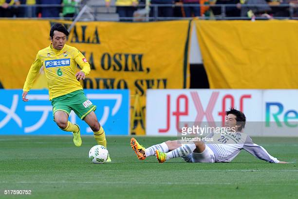 Yusuke Segawa of Thesupa Kusatsu Gunma and Masaki Yamamoto of JEF United Chiba compete for the ball during the JLeague second division match between...