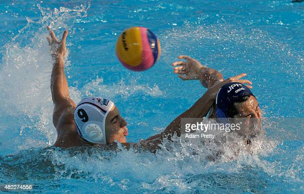 Yusuke Shimizu of Japan swims for the ball against Nikola Jaksic of Serbia in the Men's Water Polo Preliminary Round Group D match between Serbia and...