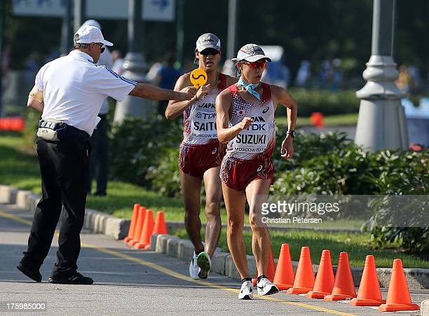 Yusuke Suzuki of Japan as Takumi Saito of Japan receives a yellow card in the Men's 20km Race Walk final during Day Two of the 14th IAAF World...