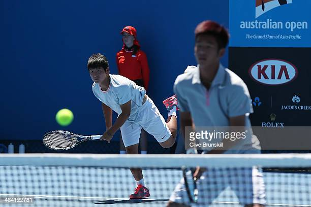 Yusuke Takahashi of Japan and Jumpei Yamasaki in their second round doubles match against Pedro Martinez Portero of Spain and Jaume Antoni Munar Clar...