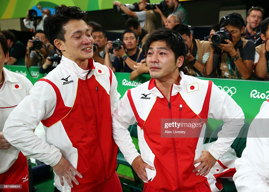 Yusuke Tanaka (L) and Koji Yamamuro (R) of Japan show their emotions after winning the gold medal in the men's team final on Day 3 of the Rio 2016 Olympic Games at the Rio Olympic Arena on August 8, 2016 in Rio de Janeiro, Brazil.