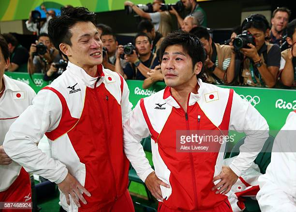 Yusuke Tanaka and Koji Yamamuro of Japan show their emotions after winning the gold medal in the men's team final on Day 3 of the Rio 2016 Olympic...
