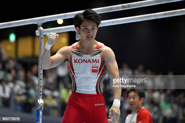 Yusuke Tanaka celebrates after competing in the Parallel Bars during Japan National Gymnastics Apparatus Championships at the Takasaki Arena on June...