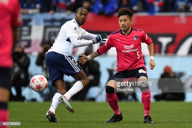Yusuke Tanaka of Cerezo Osaka and Martinus of Yokohama FMarinos compete for the ball during the 97th All Japan Football Championship final between...