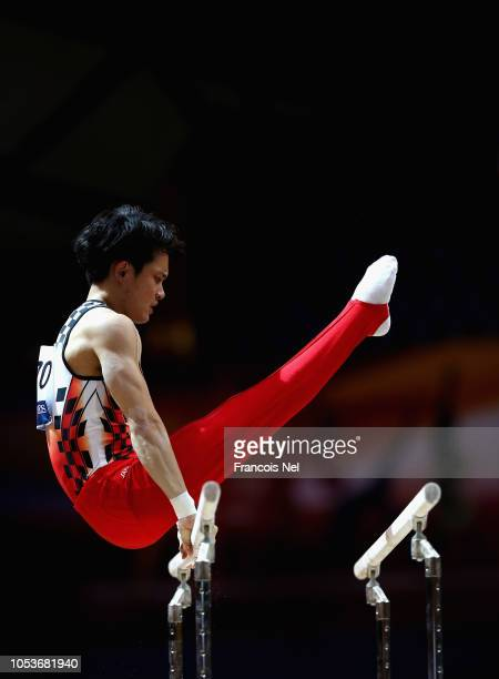 Yusuke Tanaka of Japan competes in the Men's Parallel Bars Qualification during day two of the 2018 FIG Artistic Gymnastics Championshipsat Aspire...