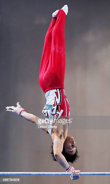 Yusuke Tanaka of Japan competes on the Horizontal Bar during the Men's Team Final of the 45th Artistic Gymnastics World Championships at Guangxi...