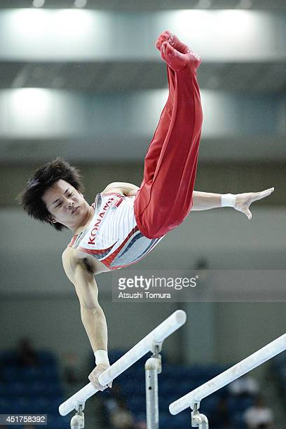 Yusuke Tanaka of Japan competes on the Parallel Bars during the 68th All Japan Gymnastics Apparatus Championships on July 6 2014 in Chiba Japan
