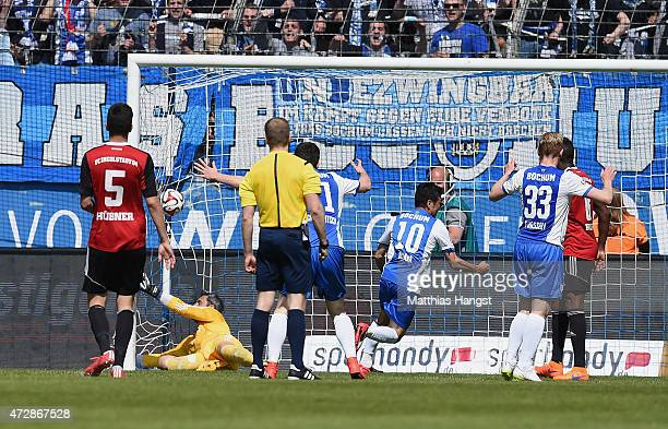 Yusuke Tasaka of Bochum celebrates with his teammates after scoring his team's third goal during the Second Bundesliga match between VfL Bochum and...