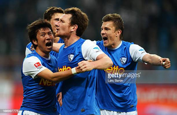 Yusuke Tasaka of Bochum celebrates with team mates Slawo Freier and Zlatko Dedic after scoring his teams third goal during the Second Bundesliga...