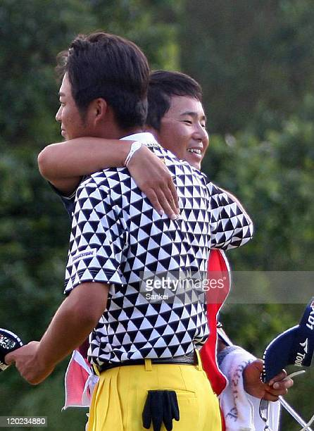 Yuta Ikeda celebrates winning the Sun Chlorella Classic with his caddie after the final round of the Sun Chlorella Classic at Otaru Country Club on...