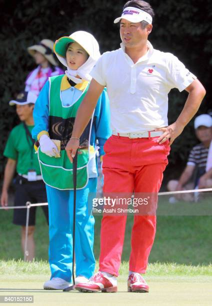 Yuta Ikeda of Japan and his caddie Arisa Yamazaki are seen during the final round of the RIZAP KBC Augusta at Keya Golf Club on August 27 2017 in...