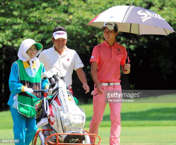 Yuta Ikeda of Japan and his caddie Arisa Yamazaki talk during the final round of the RIZAP KBC Augusta at Keya Golf Club on August 27 2017 in...