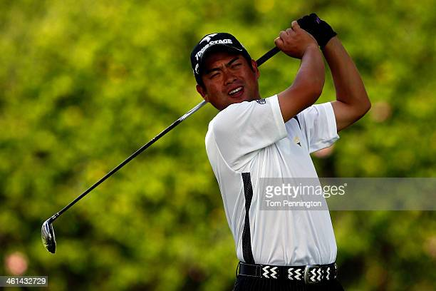 Yuta Ikeda of Japan plays a hole during the ProAm round prior to the Sony Open in Hawaii at Waialae Country Club on January 8 2014 in Honolulu Hawaii