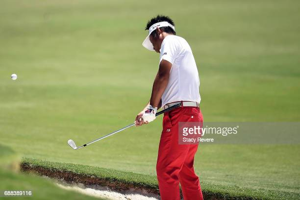 Yuta Ikeda of Japan plays a shot from a bunker on the 11th hole during Round One of the DEAN DELUCA Invitational at Colonial Country Club on May 25...
