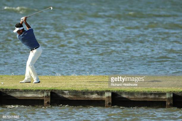Yuta Ikeda of Japan plays a shot on the 13th hole of his match during round two of the World Golf ChampionshipsDell Technologies Match Play at the...