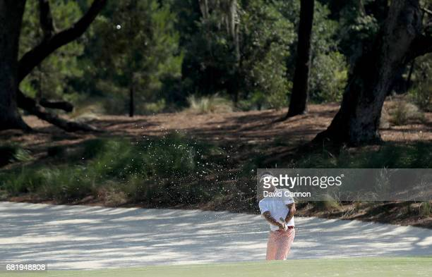 Yuta Ikeda of Japan plays his third shot on the par 4 14th hole during the first round of THE PLAYERS Championship on the Stadium Course at TPC...
