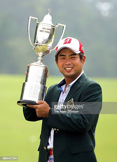 Yuta Ikeda of Japan poses for photographs with the trophy after winning the Rizap KBC Augusta at Keya Golf Club on August 30 2015 in Itoshima Fukuoka...